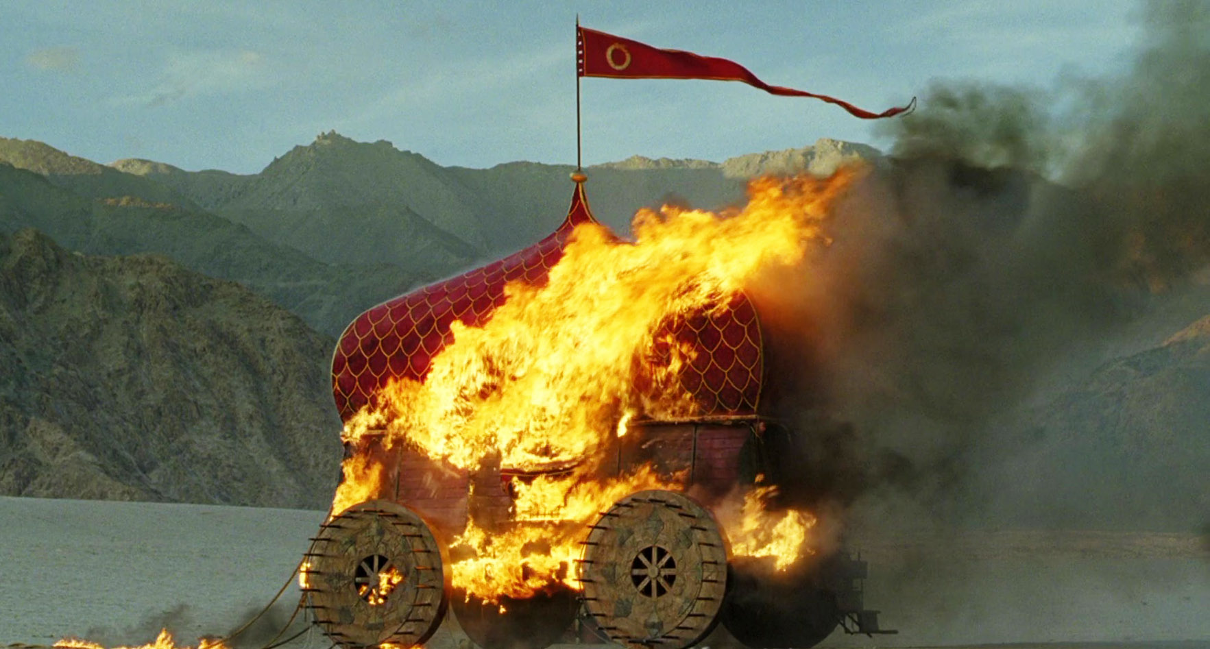 A still from the film of the palenquin carriage burning